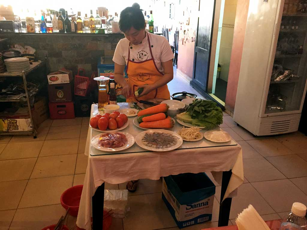 nha trang cooking class: chef flower chopping ingredients