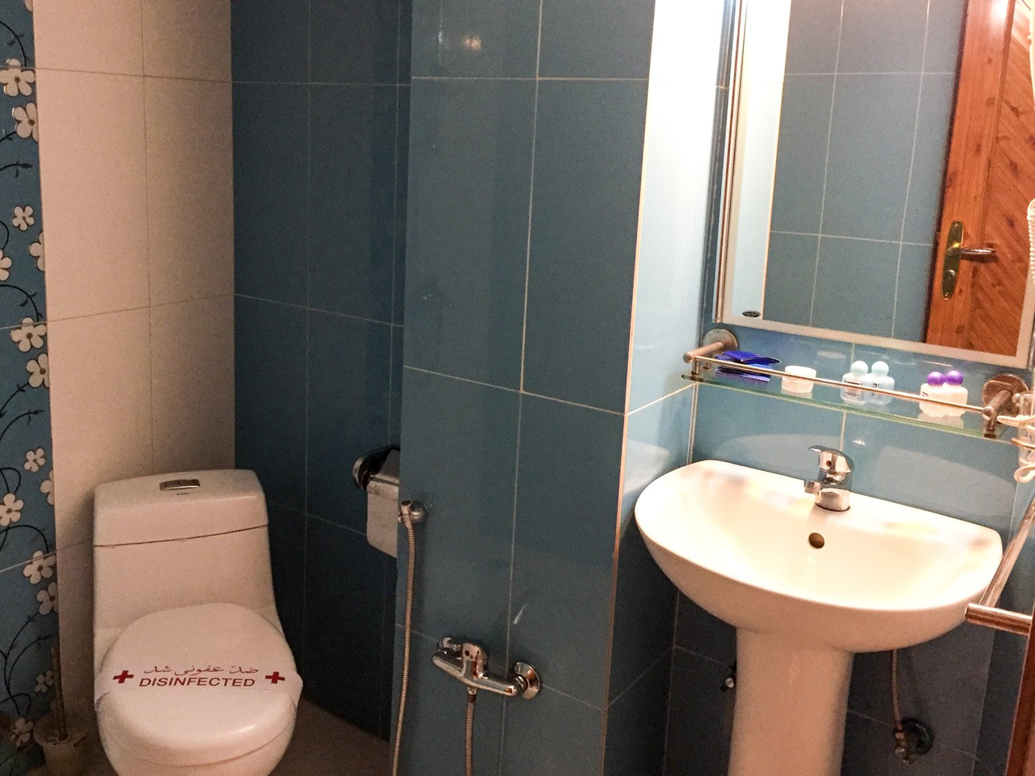 The bathroom at the Setareh Hotel Isfahan was clean with plain blue tiles