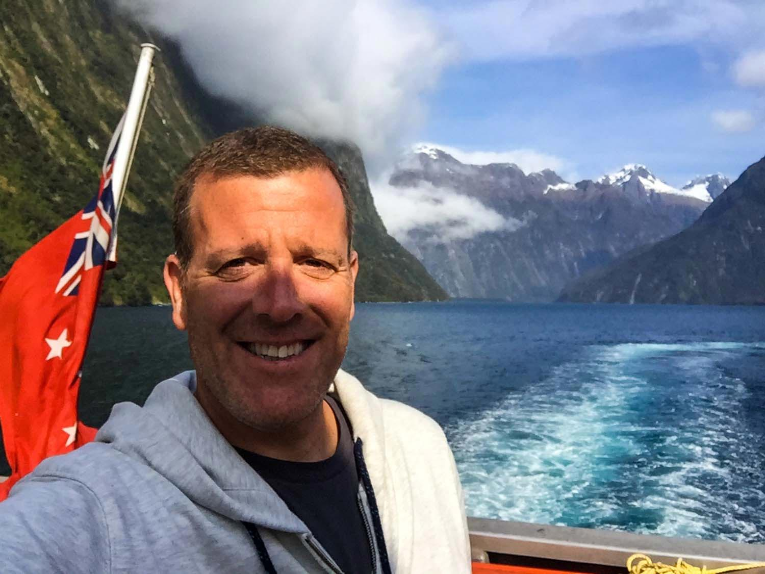 Milford Sound in New Zealand - Michael selfie with mountains in the background